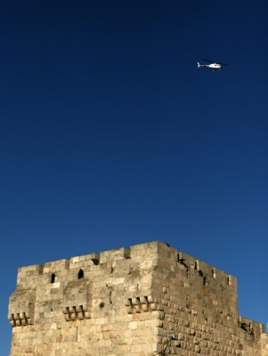 A police helicopter flies over Old City Jerusalem, Israel.