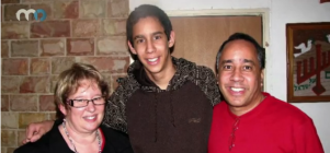 Ami Ortiz with his parents