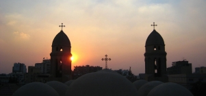 The sun sets behind a church in Cairo, Egypt. (Credit: ideacreamanuelaPps /Flickr)
