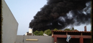 Smoke rises in Sderot after a rocket struck a factory on June 28, 2014. (Photo via Hands of Mercy)